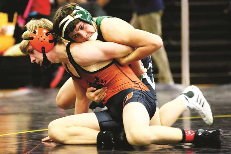 Wrestling: North Marion places third at Perry Burlison