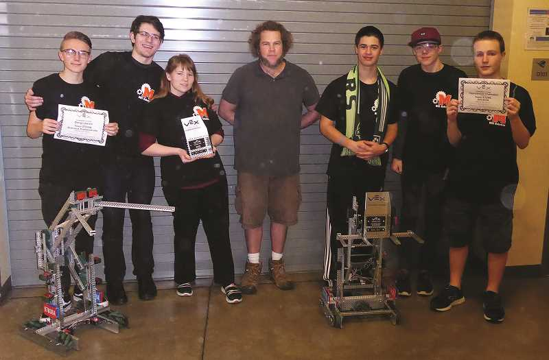 JEFF HAMMOCK - The MHS Robotics team, L to R : Gavin Connor Foster, Vandenbroeder, Jessie Arthur, Coach Zeb Schweickert, Donald Hammock, Harrison Huff, Braden Rodgers, who took home trophies Saturday from statewide competition.