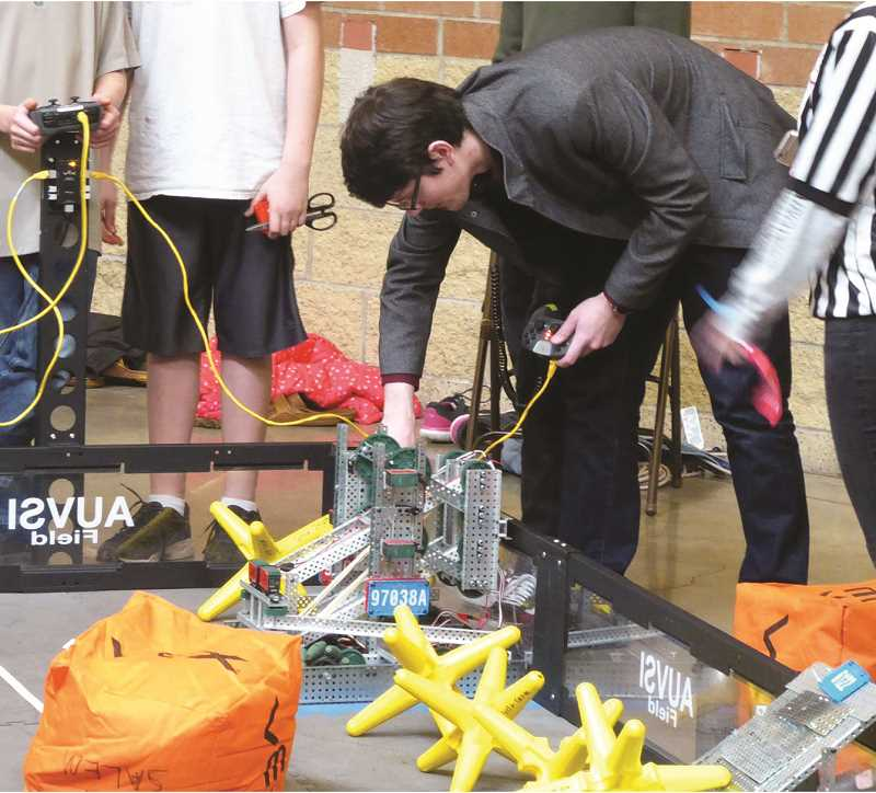 JEFF HAMMOCK - A Molalla team member puts the robot through its paces at the Saturday competiton