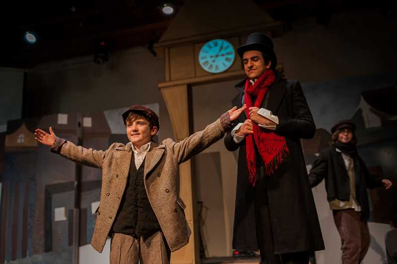 KAREN HAWLEY PHOTOGRAPHY - Alex Hugo, left, plays Tiny Tim and Brook Mackaness plays Ebenezer Scrooge in Corbett Children's Theater production of 'A Christmas Carol.'
