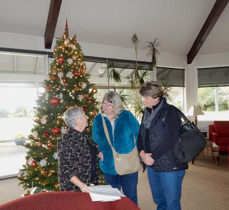 BARBARA SHERMAN - King City resident Carol Schultz (left) tells a prospective buyer (center) and her friend about King City's amenities during the Dec. 4 First Sunday, when the Clubhouse was open for tours and several brokers held open houses.