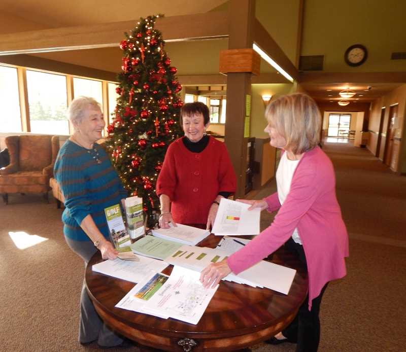 BARBARA SHERMAN - During the Dec. 4 First Sunday open house at the Summerfield Clubhouse, longtime volunteer Jeanne Ferrarin (left) chats with that day's volunteer hostesses, Joann Casciato and Barbara Schultz.