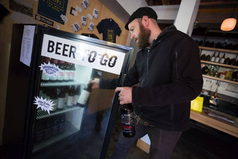 PAMPLIN MEDIA GROUP: JONATHAN HOUSE - Baerlic Brewing owner Ben Parsons stocks his beer-to-go fridge with bottled, not canned, beer.