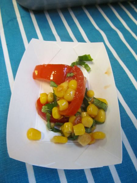 PHOTO BY ELLEN SPITALERI - This corn and tomato salad was offered free in October to students at New Urban High School. The tomatoes and basil were grown on the NUHS farm behind the school.