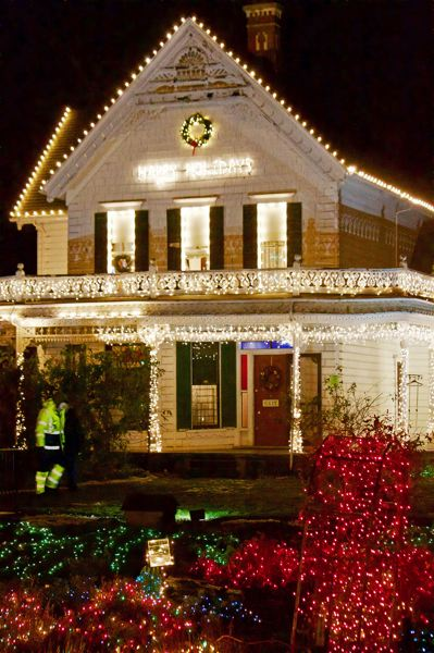 OUTLOOK PHOTO - WinterVille organizers put up an estimated 40,000 lights across the Zimmerman Heritage Farmhouse and property.