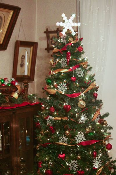 OUTLOOK PHOTO - Inside the Zimmerman House visitors can enjoy holiday decorations and music while taking a guided tour.