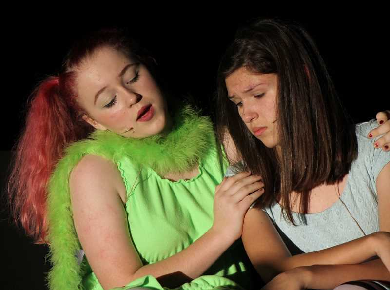 CONNECTION PHOTO: HANNAH RANK - Hyacinth Fick (left) comforts Abbi Biggs, who plays Alice and worries she'll never find her way out of Wonderland and back into cellphone range.