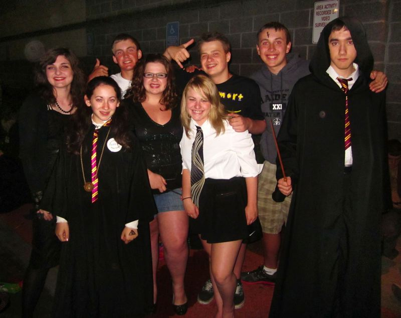 FILE - Teens dress up in 'Harry Potter' costumes for the opening of 'Harry Potter and the Deathly Hallows: Part 2' in 2011.