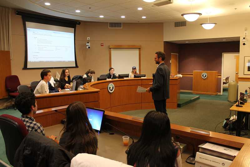 REVIEW PHOTO: ANTHONY MACUK - City Councilor Joe Buck explains Roberts Rules of Order, the parliamentary procedures that all of Lake Oswego's councils, boards and commissions use to conduct meetings, to Youth Council members.