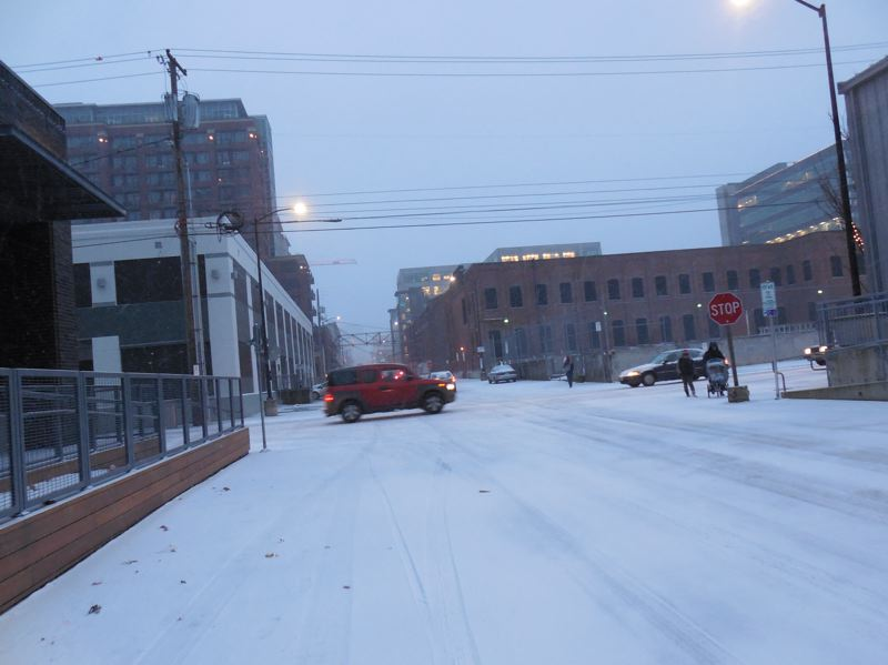 TRIBUNE PHOTO: JOSEPH GALLIVAN - Roads in the Pearl District were lightly traveled during Wednesday afternoon's snowstorm.