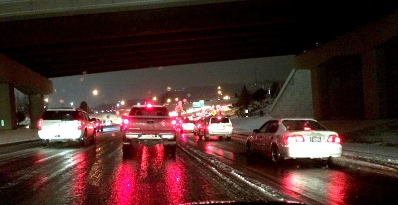 TRIBUNE PHOTO: TIFFANEY O'DELL - Traffic on Interstate 205 was jammed for hours Wednesday night as snow and slick roads made travel a slow slog.