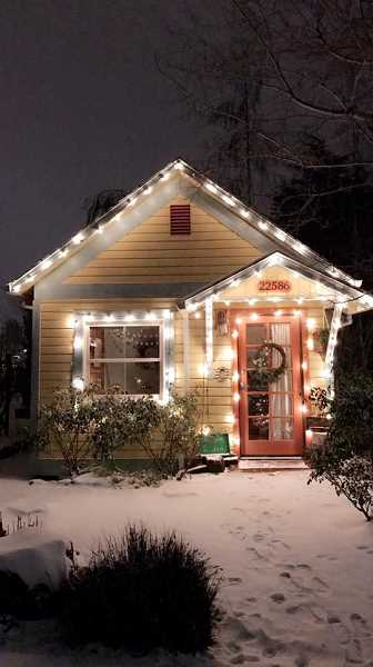 COURTESY OF SARAH OTTESON - A Sherwood home is caught in a festive photo shot during the Dec. 14 snowstorm.