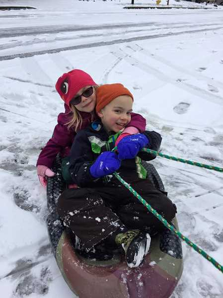 COURTESY OF APRIL GILBERTSON  - Two young Sherwood residents take to the street on their sled, enjoying a fun ride during the Dec/ 14 storm.