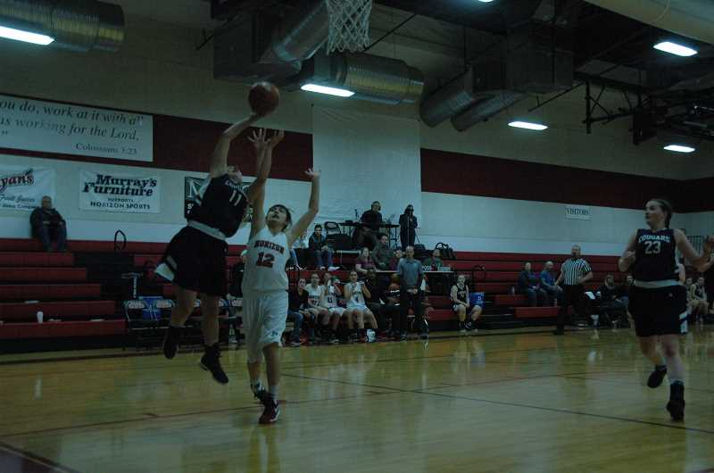 Cougars score season-high in 75-40 win over Hawks