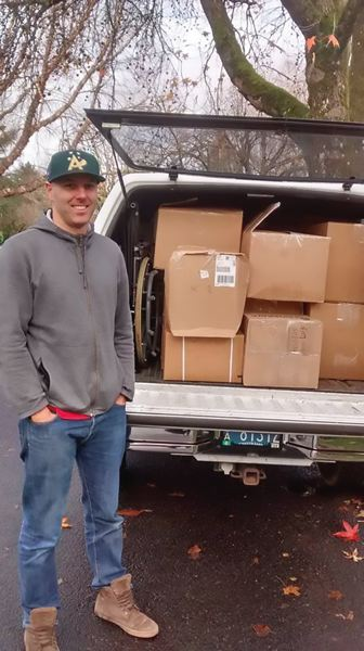 COURTESY PHOTO: LISA ORTIZ - Portland firefighter Gary Fergus stands near his truck loaded with food and other supplies bound for North Dakota.