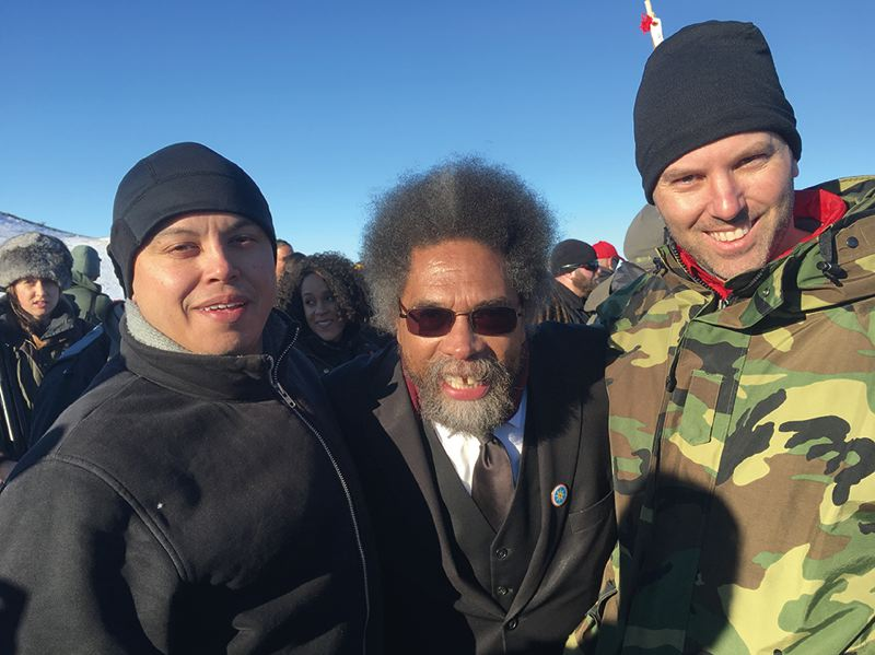 COURTESY PHOTO: GARY FERGUS - Gabe Sheoships (left), activist Cornel West and Portland firefighter Gary Fergus at the protest site.