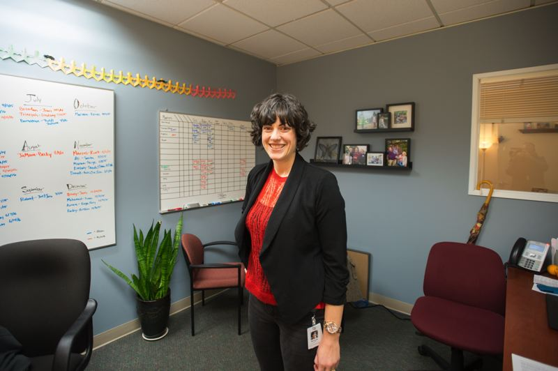 OUTLOOK PHOTO: JOSH KULLA - One of the best benefits of the partnership between Family of Friends and the city of Gresham is the office space in City Hall, where Executive Director Michelle Kosta works to generate a pool of mentors in the community.