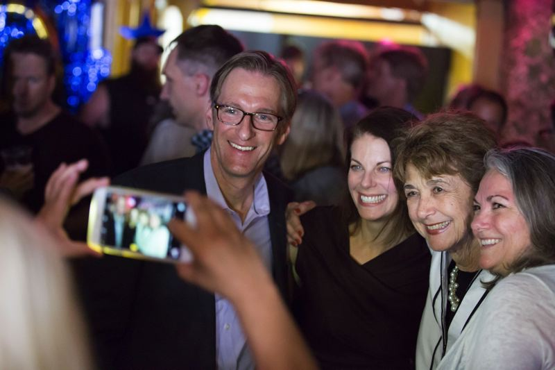 PORTLAND TRIBUNE FILE PHOTO - Ted Wheeler takes selfies with election-night supporters after a surprisingly solid win in the May primary.