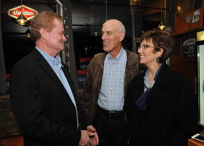 REVIEW PHOTO: VERN UYETAKE - Skip O'Neil chats with Kent and Kim Studebaker at a post-election gathering at Pine Shed Ribs and Barbecue. Studebaker was re-elected mayor in November and O'Neill won a second term on the City Council.