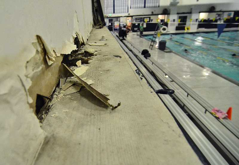 REVIEW PHOTO: VERN UYETAKE - Wooden beams sag and brown moisture blotches dot the deteriorating walls of the Lake Oswego School District's 45-year-old pool facility. A $187 million bond measure proposed for the May 2017 ballot includes funds to replace the popular facility.