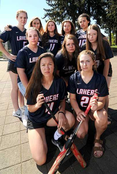 REVIEW PHOTO: VERN UYETAKE - Ten current or former softball players at Lake Oswego High School have filed a federal Title IX lawsuit against the school district, claiming they have been denied equal access to the kinds of equipment, facilities, funding and publicity enjoyed by male athletes.