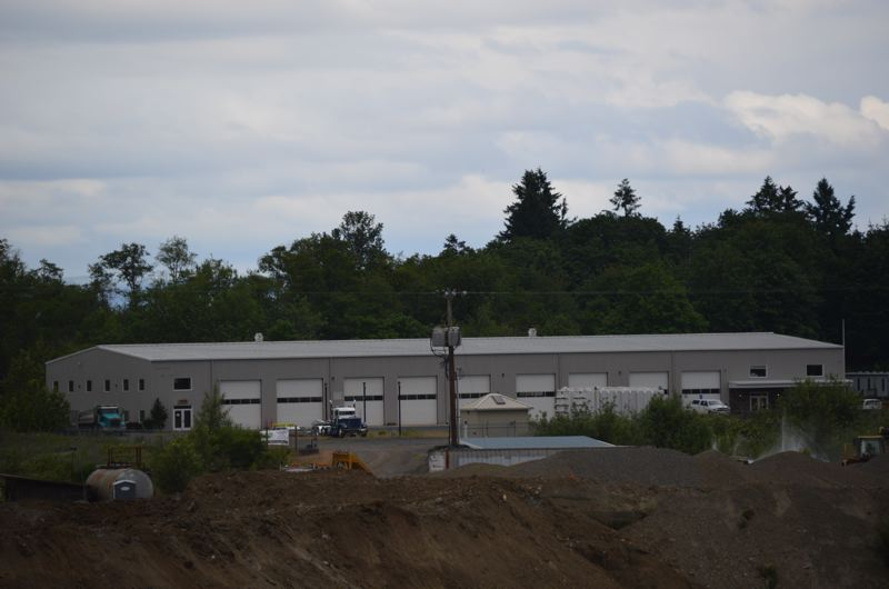 SPOTLIGHT FILE PHOTO - An unassuming building adjacent to a gravel pit in Scappoose is the future home of the Oregon Manufacturing Innovation Center. The OMIC is pegged to be a cutting edge educational and workforce training center.