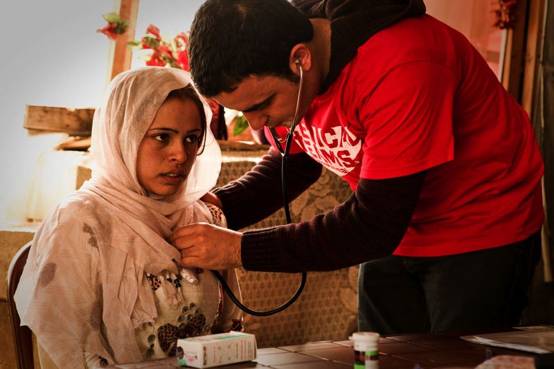 COURTESY OF MEDICAL TEAMS INTERNATIONAL - A Syrian refugee in Lebanon gets a checkup from Medical Teams International.