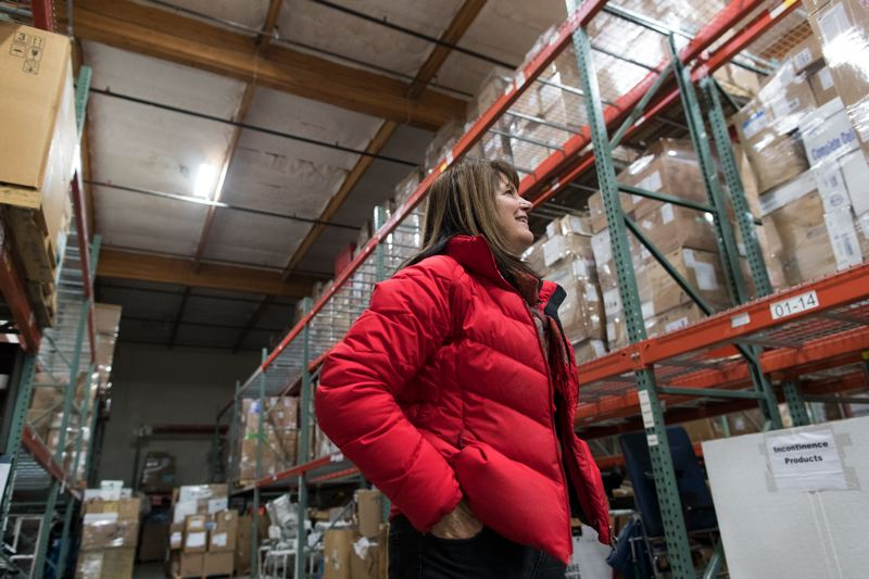 PMG PHOTO: JAIME VALDEZ - Gail Mannex, manager of logistics for Medical Teams International, looks at pallets full of medical supplies in the warehouse of the Tigard-based nonprofit.