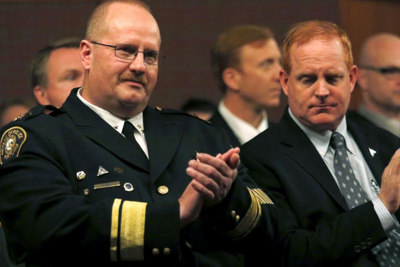 TRIBUNE FILE PHOTO - Former Portland Police Chief Larry O'Dea, left, may use the defense that his .22-caliber rifle was defective when it fired and injured a friend in Eastern Oregon last year.