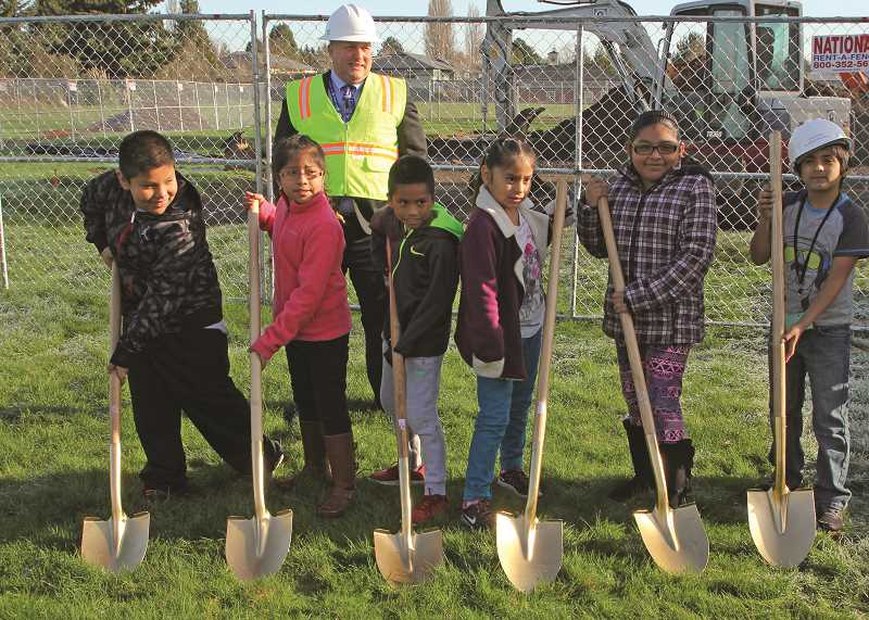 INDEPENDENT PHOTO: JULIA COMNES - Superintendent Chuck Ransom stands with Washington Elementary School students at the groundbreaking for the most recent bond project on the school property, which started in December.
