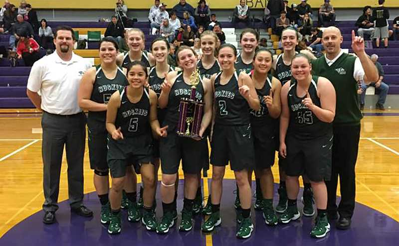 COURTESY PHOTO - The North Marion girls basketball team celebrates its 48-40 victory over Hockinson in the championship game of the Vince Dulcich Memorial Tournament.
