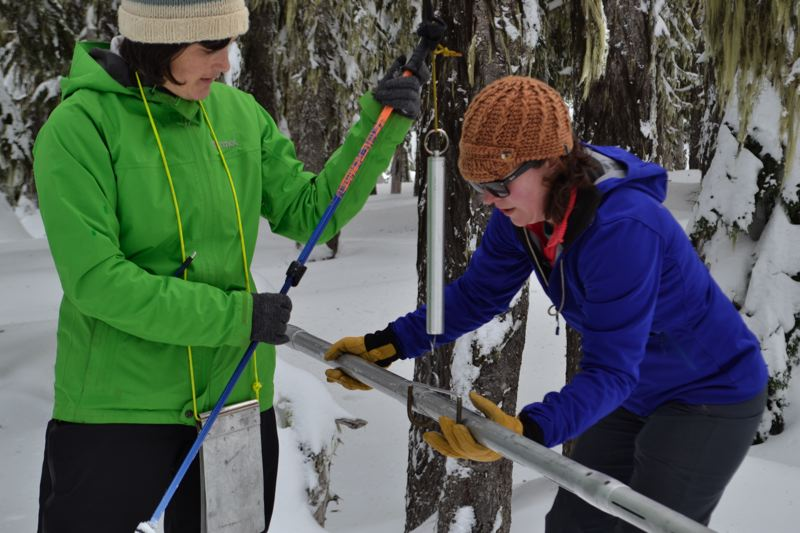 POST PHOTO: BRITTANY ALLEN - Snow hydrologists Amy Burke and Julie Koeberle measure the snow tube to find the water content.