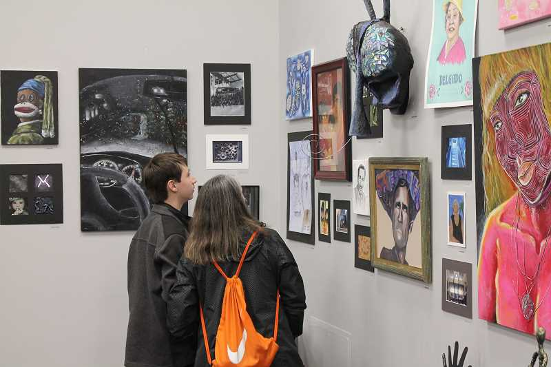 WHS student artists bring life to local dealership