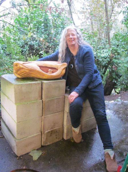 PHOTO BY ELLEN SPITALERI   Milwaukie Resident Carole Murphy Uses These  70 Pound Blocks Of