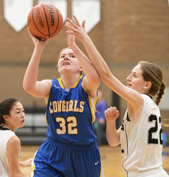 LON AUSTIN/CENTRAL OREGONIAN - Tiffany Smith goes up for two of her seven points in the Cowgirls' 44-36 loss to Sisters Wednesday evening. Smith also pulled down nine rebounds in the contest.