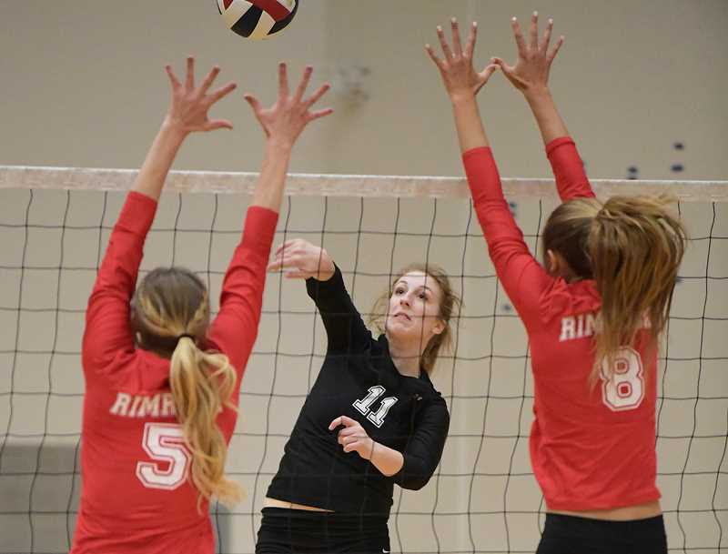 LON AUSTIN/CENTRAL OREGONIAN - Crook County High School star Jennifer Roth, on the Rimrock Black team, goes up for a kill against the Rimrock Nationals team. The Rimrock Nationals team, made up of players from throughout Central Oregon, narrowly defeated the Black team, which is predominantly Crook County players, in the tournament championship.