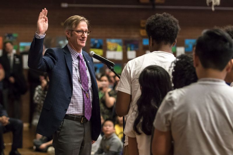 PORTLAND TRIBUNE: JONATHAN HOUSE - Mayor Ted Wheeler takes the oath of office from student at Jason Lee Elementary School on Wednesday.