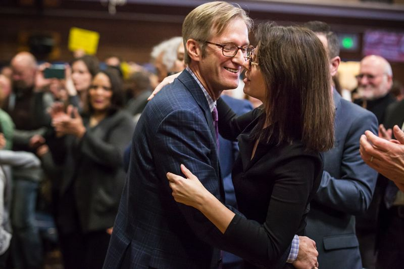 PORTLAND TRIBUNE: JONATHAN HOUSE - Mayor Ted Wheeler hugs his wife Katrina after making Inaugural remarks.