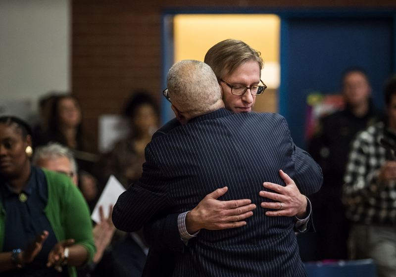 PORTLAND TRIBUNE: JONATHAN HOUSE - Ted Wheeler hugs the Albina Ministerial Alliance's Rev. Dr. Leroy Haynes, Jr. during his inauguration event.