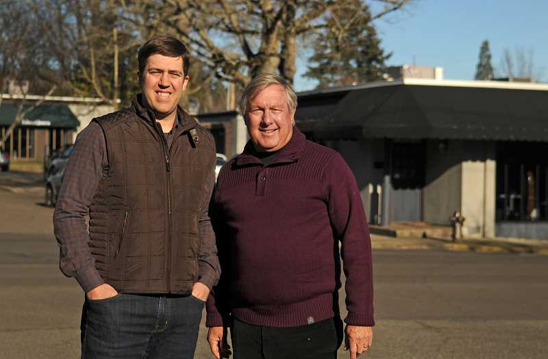 REVIEW PHOTO: VERN UYETAKE - Developers Miles (left) and Jay Haladay stand in front of their current 10 Branch office in downtown Lake Oswego. It sits on the site of a proposed new development that would extend north from the northeast corner of B Avenue and Third Street.