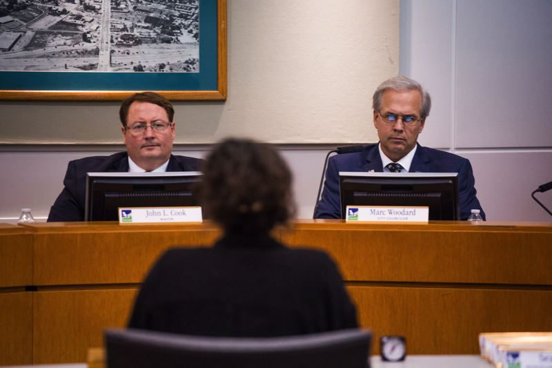 TIMES PHOTO: ADAM WICKHAM - Mayor John L. Cook and Councilor Marc Woodard listen to Hannah Holloway's presentation.