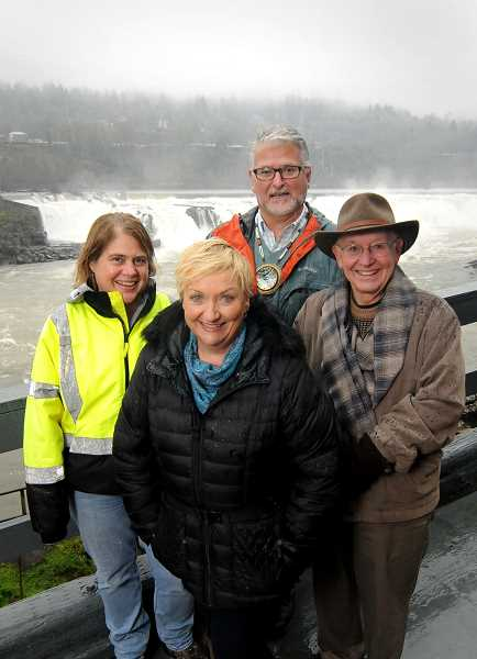 TIDINGS PHOTO: VERN UYETAKE - From left to right, coalition members Jon George of The Confederated Tribes of Grand Ronde, Penny Machinski of West Linn Paper Company, Siobhan Taylor and Jim Mattis pose in front of the Willamette Falls.