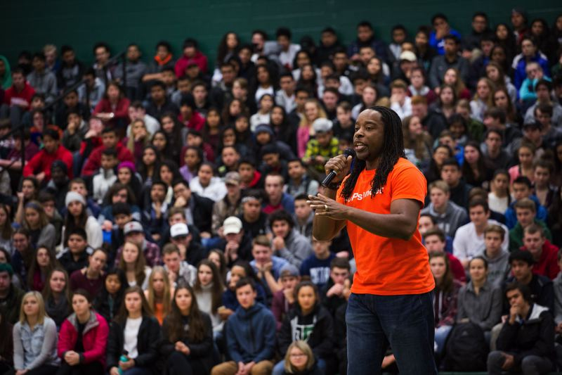 TIMES PHOTO: ADAM WICKHAM - Omekongo Dibinga addresses students during a human rights assembly in the Tigard High School gymnasium.