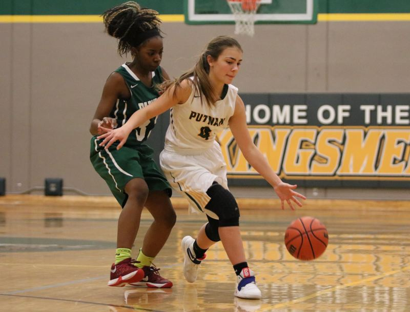 REVIEW/NEWS PHOTO: JIM BESEDA - Putnam's Abigail Paul (right) handles the ball under pressure from Parkrose's Ayrianna McKinney during the second half of Friday's Northwest Oregon Conference game at Putnam High School.
