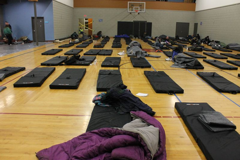 TRIBUNE PHOTO: LYNDSEY HEWITT - On Jan. 1, the first night of Portland's ongoing cold snap, 38 people sought shelter at Imago Dei emergency shelter, 1302 S.E. Ankeny St. Since then, hundreds have come through the shelter.