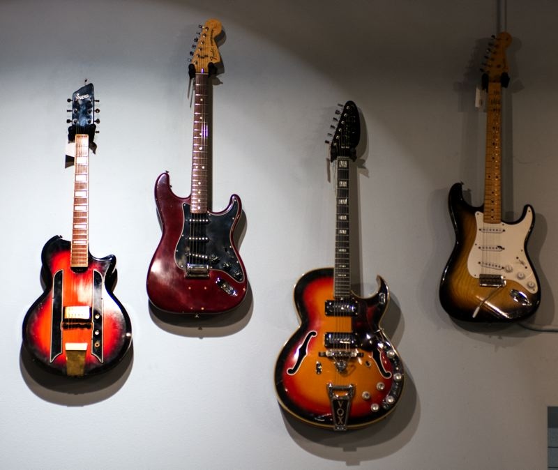 PAMPLIN MEDIA GROUP: JOHN VINCENT - Mounted high on the walls of the company's Martin Luther King Jr. Boulevard story is an array of historic and collectable guitars including vintage Fender Stratocasters. The company takes older instruments in trade or consignment.