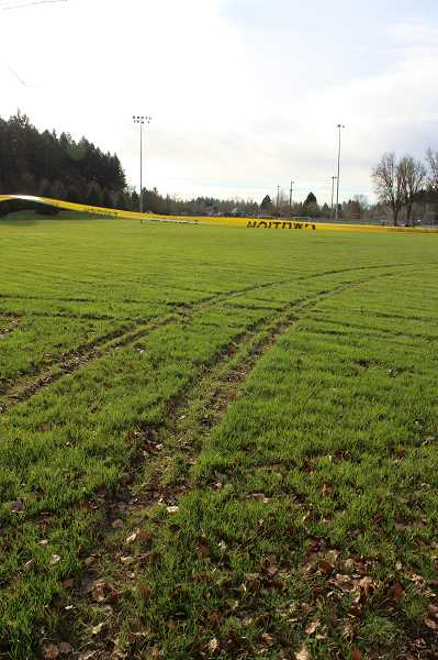 SPOKESMAN PHOTO - With no curbs surrounding the fields, vehicles can easily access the turf from almost all sides. Parks Supervisor Tod Blankenship said that curbs and better surveillance cameras are on the docket for the Memorial Park master plan, but until those plans come to fruition the fields will remain largely unprotected.