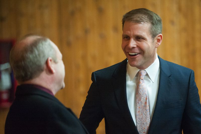OUTLOOK PHOTO: JOSH KULLA - Mayor Casey Ryan greets fellow City Councilor Rich Allen.