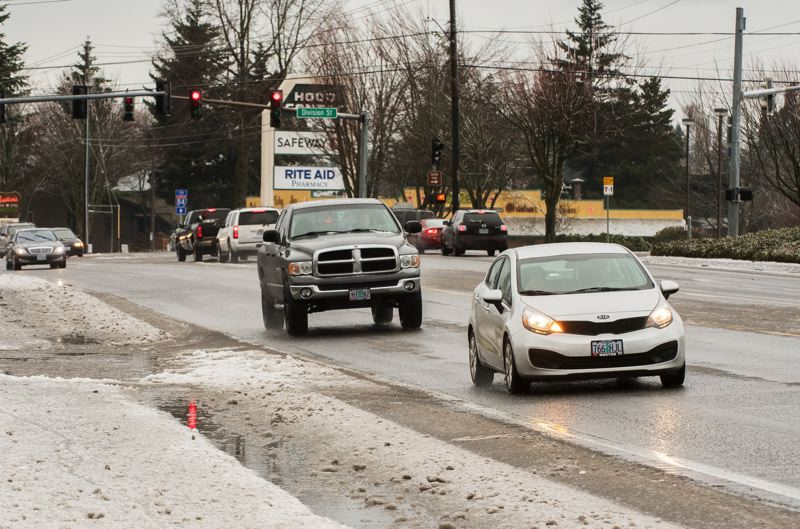 OUTLOOK PHOTO: JOSH KULLA - Traffic was light on Gresham area roads Monday, as the remnants of the weekend's ice storm continued to make driving dicey in some spots during the morning commute.