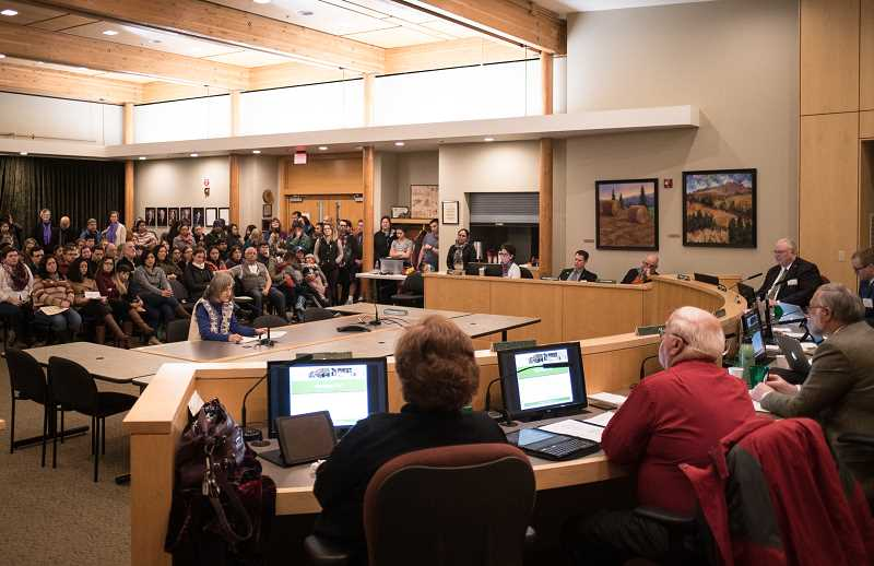 NEWS-TIMES PHOTO: CHASE ALLGOOD - Bridget Cooke of Adelante Mujeres speaks in favor of the sanctuary city designation before a standing-room-only crowd.